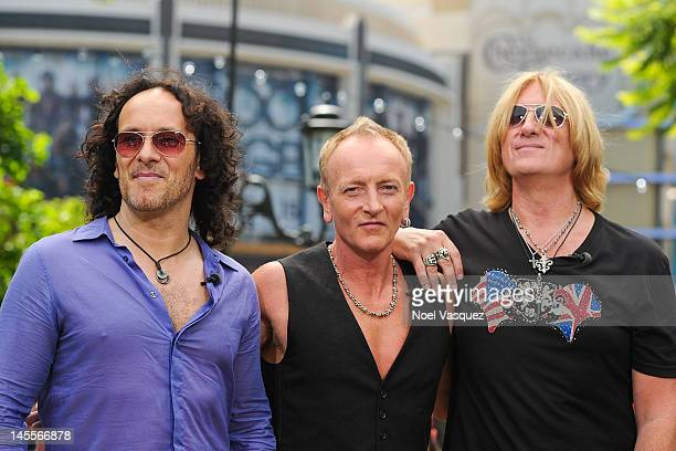 """Vivian Campbell, Phil Collen and Joe Elliott of Def Leppard visit """"Extra"""" at The Grove on June 1, 2012 in Los Angeles, California."""