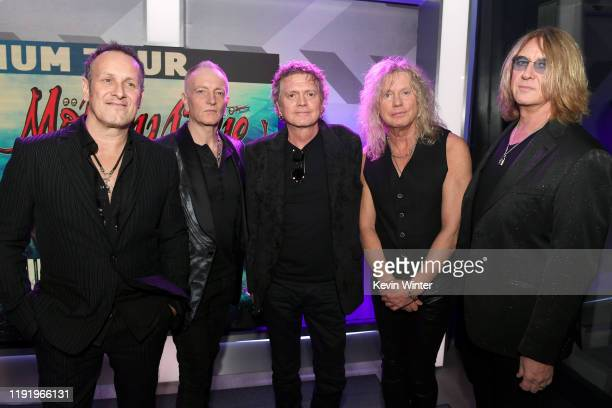Vivian Campbell Phil Collen Rick Allen Rick Savage and Joe Elliott of Def Leppard attend the Press Conference with Mötley Crüe Def Leppard and Poison...
