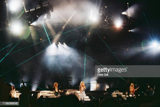 Vivian Campbell, Rick Savage, Rick Allen , Joe Elliot and Phil Collen of Def Leppard perform on stage with laser light stage effects at The Don...