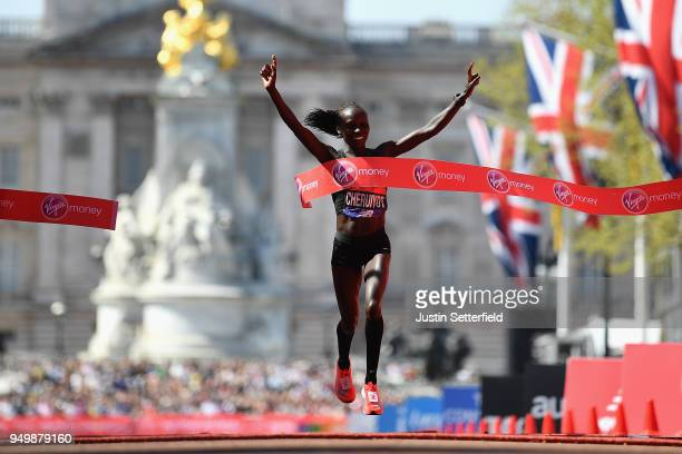 Vivian Cheruiyot of Kenya celebrates after crossing the finish line to win the women's race during the Virgin Money London Marathon at United Kingdom...