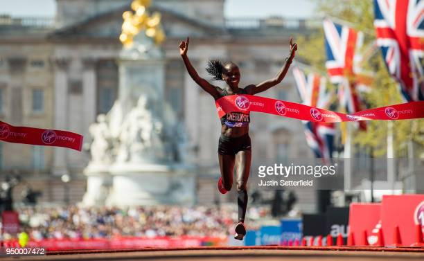 Vivian Cheruiyot of Kenya celebrates after crossing the finish line to win the elite women's race during the Virgin Money London Marathon at United...