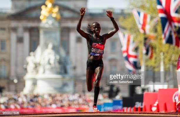 Vivian Cheruiyot of Kenya celebrates after crossing the finish line to win the elite women's race during the Virgin Money London Marathon at United...