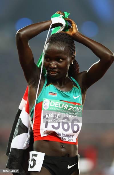Vivian Cheruiyot of Kenya celebrates winning gold in the women's 5000 metres final at Jawaharlal Nehru Stadium during day nine of the Delhi 2010...