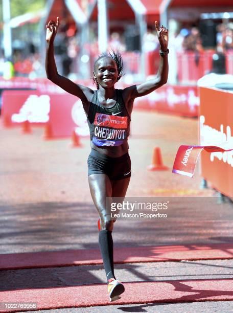 Vivian Cheruiyot of Kenya crosses the finish line on the Mall during the Virgin London Marathon on April 22 2018 in London Cheruiyot won in a time of...