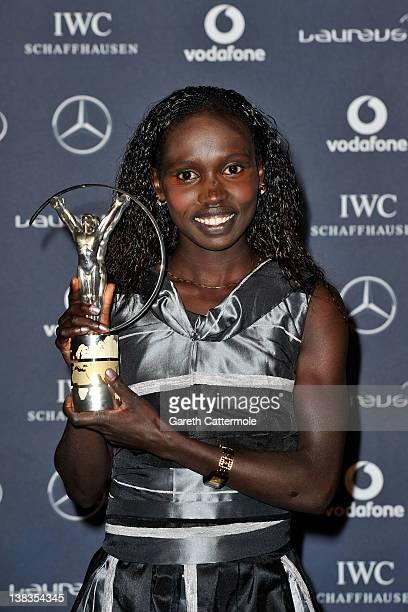 Vivian Cheruiyot poses with her Laureus World Sportswoman of the Year trophy in the press room at the 2012 Laureus World Sports Awards at Queen...