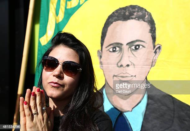 Vivian Figueiredo stands in front of a banner showing her cousin Jean Charles de Menezes as she attends a memorial to mark the 10th anniversary of...