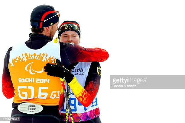 Vivian Hoesch of Germany hugs her guide Norman Schlee after crossing the finish line in the Women's Cross Country 5km Free – Visually Impaired on day...