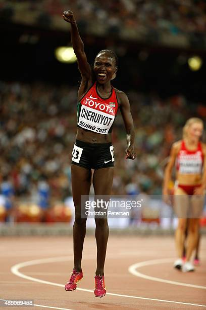Vivian Jepkemoi Cheruiyot of Kenya celebrates after winning gold in the Women's 10000 metres final during day three of the 15th IAAF World Athletics...