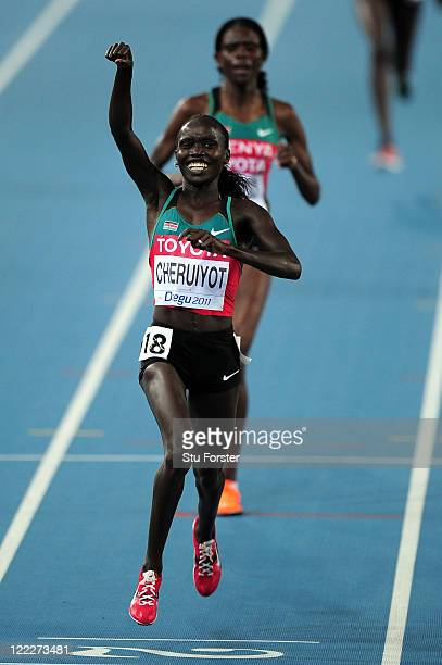 Vivian Jepkemoi Cheruiyot of Kenya celebrates as she crosses the finish line to win the women's 10,000 metres final during day one of the 13th IAAF...
