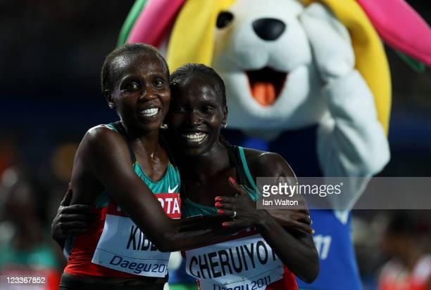 Vivian Jepkemoi Cheruiyot of Kenya celebrates winning the women's 5000 metres final with Sylvia Jebiwott Kibet of Kenya during day seven of 13th IAAF...