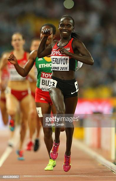 Vivian Jepkemoi Cheruiyot of Kenya crosses the finish line to win gold in the Women's 10000 metres final during day three of the 15th IAAF World...