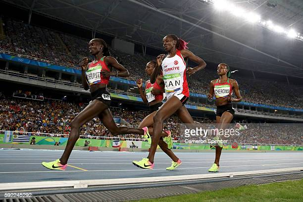 Vivian Jepkemoi Cheruiyot of Kenya leads the field in the Women's 5000m Final on Day 14 of the Rio 2016 Olympic Games at the Olympic Stadium on...