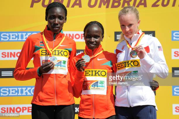 Vivian Jepkemoi Cheruiyot of Kenya poses with her gold medal after victory in Senior Women's race alongside silver medalist Linet Chepkwemoi Masai of...