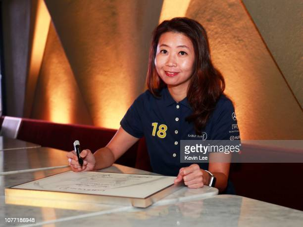 Vivian Lee Ying Shih signs the certificate before the Laureus Hong Kong Ambassador Announcement ceremony at Mercedes Me Store on December 04 2018 in...