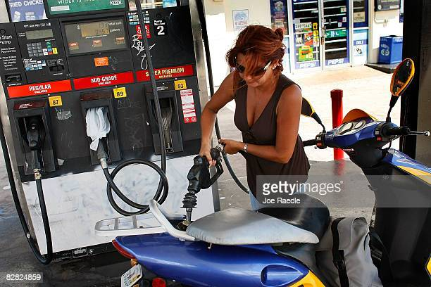 Vivian Lopez puts gas into her scooter September 15 2008 in Miami Florida Gasoline prices rose nearly 5 cents a gallon Monday bringing the total...
