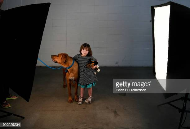 Vivian Naeser 2 and Stoney a 2 year old Rhodesian Ridgeback pose for a portrait during the Colorado Kennel Club Dog Show at the National Western...