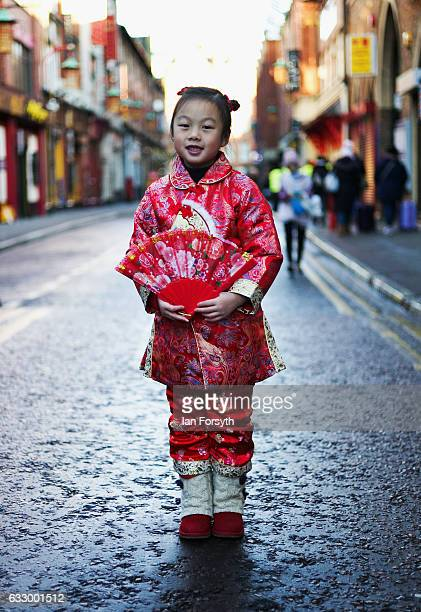 Viviana Cheung from Newcastle Upon Tyne poses in her traditional clothing during the Chinese New Year celebrations to mark The Year of the Rooster on...