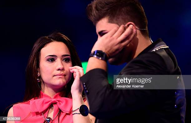 Viviana Grisafi and Severino Seeger react during the first round of elimination during the live finals of the television show 'Deutschland sucht den...
