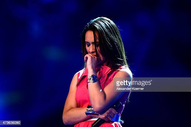 Viviana Grisafi reacts during the first round of elimination during the live finals of the television show 'Deutschland sucht den Superstar' on May...