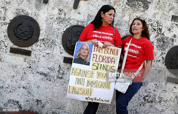 Viviana Ivalo and Cecilia Chaar join with other protesters to ask that Florida Attorney General Pam Bondi withdraw the state of Florida from the list...
