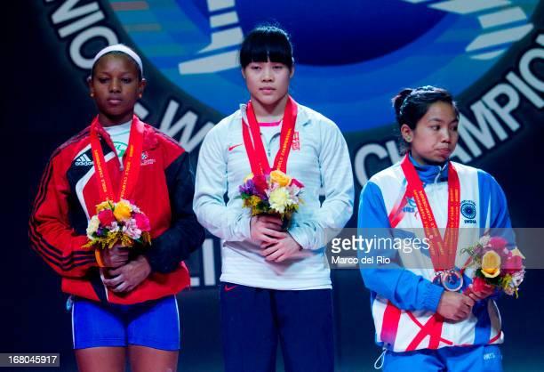Viviana Munoz of Domincan Republic A , Chunying Guan of China A and Mirabai Chanu Saikhom of India A stand in the podium in the Women's 48kg awards...