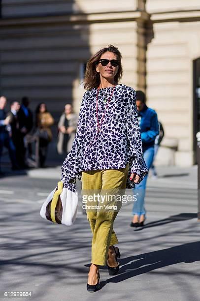 Viviana Volpicella outside Miu Miu on October 5 2016 in Paris France