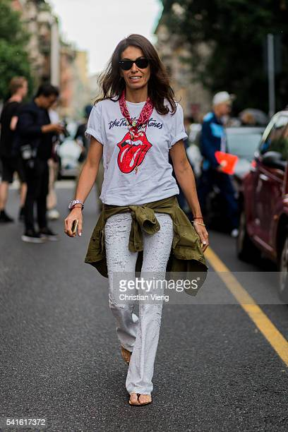 Viviana Volpicella outside Prada during the Milan Men's Fashion Week Spring/Summer 2017 on June 19 2016 in Milan Italy