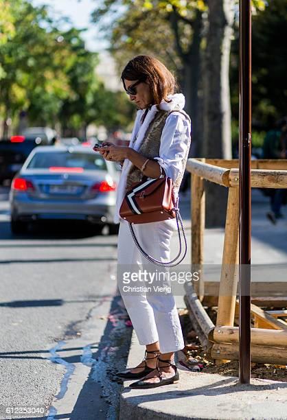 Viviana Volpicella outside Sacai on October 3 2016 in Paris France