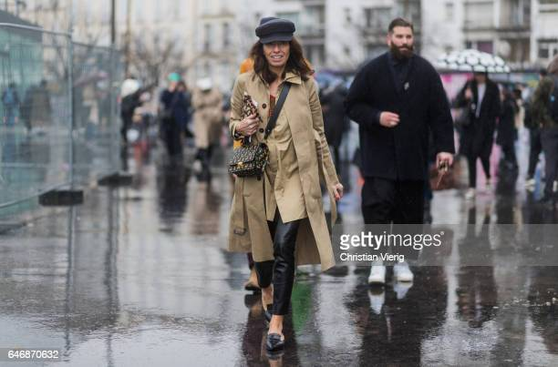 Viviana Volpicella wearing a beige trench coat flat cap outside Dries Van Noten on March 1 2017 in Paris France