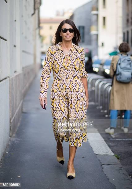Viviana Volpicella wearing a dress is seen outside Bottega Veneta during Milan Fashion Week Spring/Summer 2018 on September 23 2017 in Milan Italy