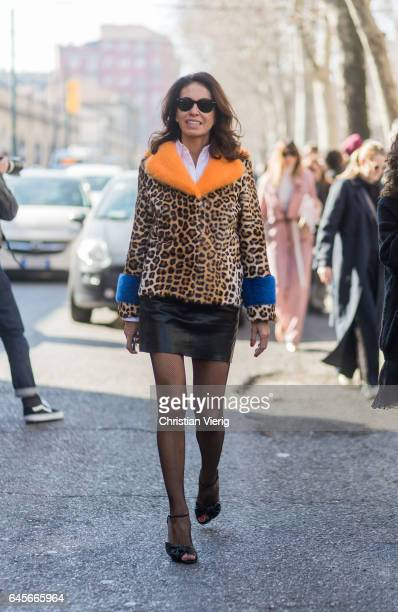 Viviana Volpicella wearing a leopard print coat black mini skirt tights outside Marni during Milan Fashion Week Fall/Winter 2017/18 on February 26...