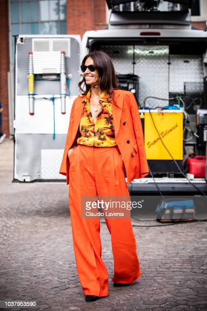 Viviana Volpicella wearing Balenciaga shirt and Alberto Biani orange suit is seen before the Philosophy by Lorenzo Serafini show during Milan Fashion...