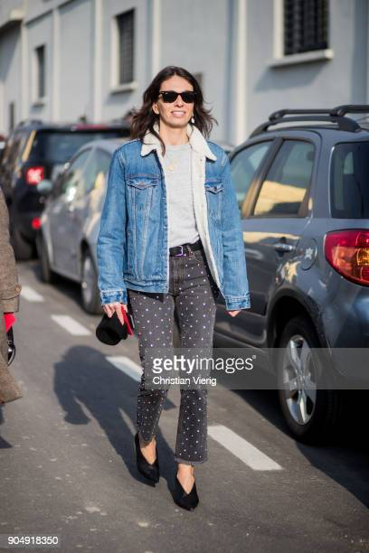 Viviana Volpicella wearing denim jacket is seen outside DSquared2 during Milan Men's Fashion Week Fall/Winter 2018/19 on January 14 2018 in Milan...