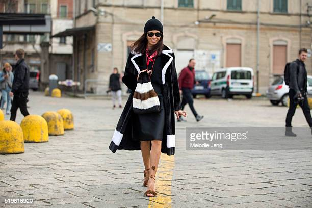 Viviana Volpicella wears a black fur coat with white details a black hat red bandana around her neck a Simonetta Ravizza fur Furrissima bag and brown...