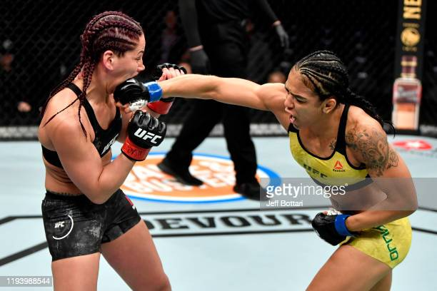Viviane Araujo of Brazil punches Jessica Eye in their women's flyweight bout during the UFC 245 event at TMobile Arena on December 14 2019 in Las...
