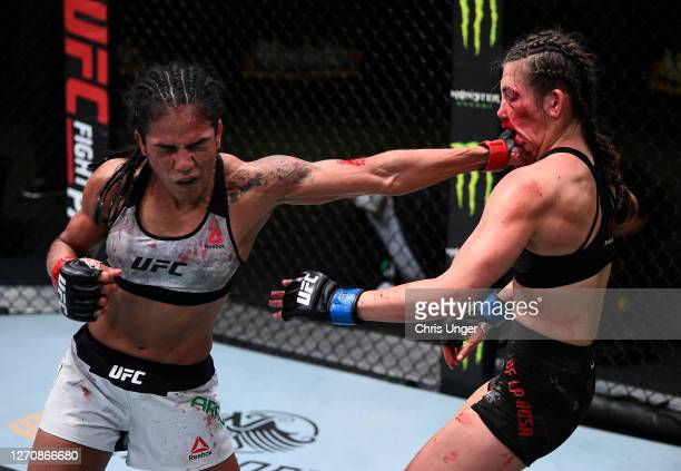 Viviane Araujo of Brazil punches Montana De La Rosa in a flyweight fight during the UFC Fight Night event at UFC APEX on September 05, 2020 in Las...