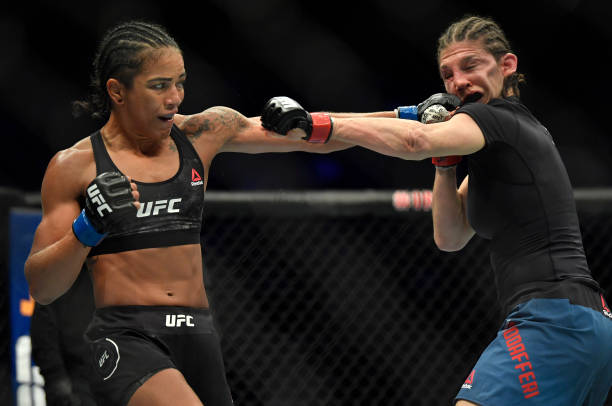 Viviane Araujo of Brazil punches Roxanne Modafferi in a flyweight fight during the UFC Fight Night event at Etihad Arena on UFC Fight Island on...