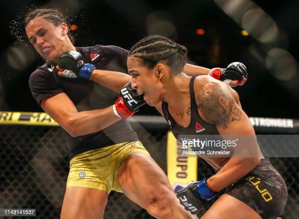 Viviane Araujo of Brazil punches Talita Bernardo of Brazil in their women's bantamweight bout during the UFC 237 event at Jeunesse Arena on May 11...