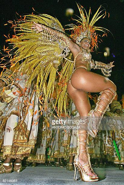 Viviane Araujo Queen of the Drums of Mocidade Independente samba school performs ahead of the drums' band 06 February 2005 in Rio de Janeiro's...
