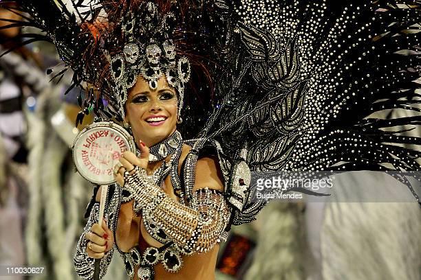 Viviane Araujo queen of the drums of Salgueiro dances during the samba school champions parade at Marques de Sapucai on March 12 2011 in Rio de...