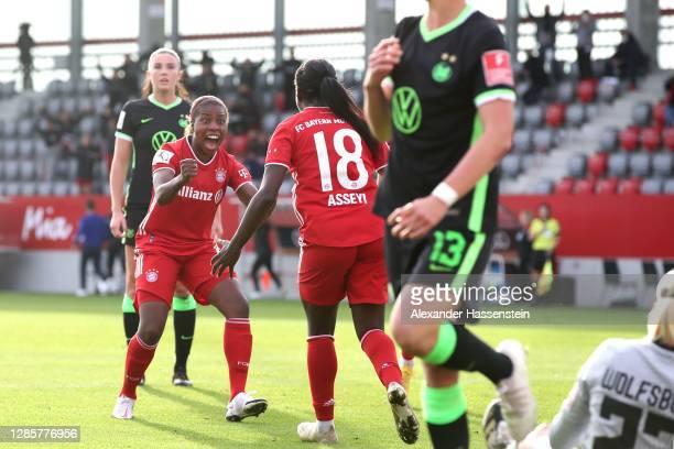 Viviane Asseyi of Bayern München celebrates scoring the opening goial with her team mate Lineth Beerensteyn during the Flyeralarm Frauen Bundesliga...
