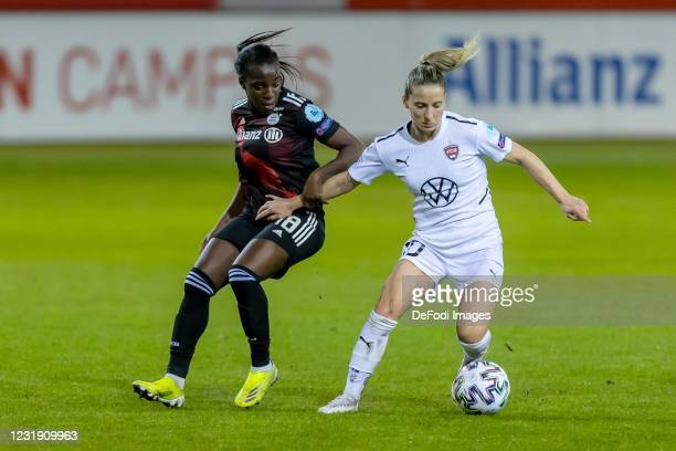 Viviane Asseyi of FC Bayern Munich and Jelena Cankovic of FC Rosengard battle for the ball during the First Leg of the UEFA Women's Champions League...