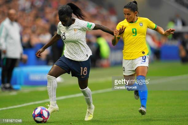 Viviane Asseyi of France attacking against Debinha of Brazil during the 2019 FIFA Women's World Cup France Round Of 16 match between France and...