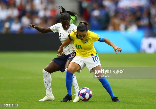 Viviane Asseyi of France battles for possession with Marta of Brazil during the 2019 FIFA Women's World Cup France Round Of 16 match between France...