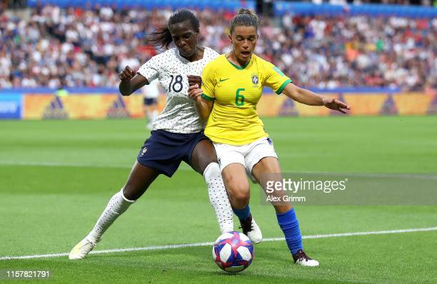 Viviane Asseyi of France battles for possession with Tamires of Brazil during the 2019 FIFA Women's World Cup France Round Of 16 match between France...