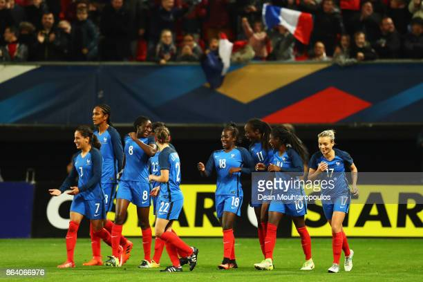 Viviane Asseyi of France celebrates scoring his teams first goal of the game with team mates during the International friendly match between France...