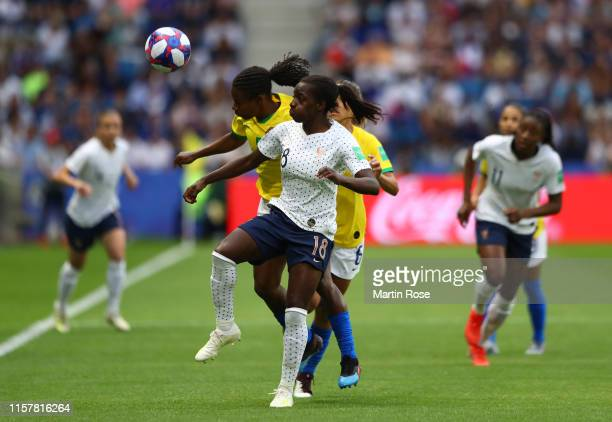 Viviane Asseyi of France competes for a header with Formiga of Brazil during the 2019 FIFA Women's World Cup France Round Of 16 match between France...