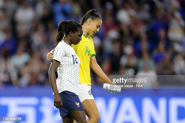 Viviane Asseyi of France consoles Kathellen of Brazil following the 2019 FIFA Women's World Cup France Round Of 16 match between France and Brazil at...
