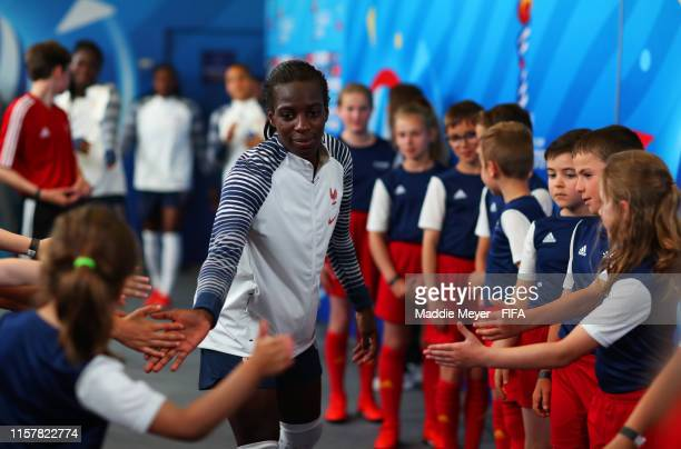 Viviane Asseyi of France interacts with mascots in the tunnel prior to the 2019 FIFA Women's World Cup France Round Of 16 match between France and...