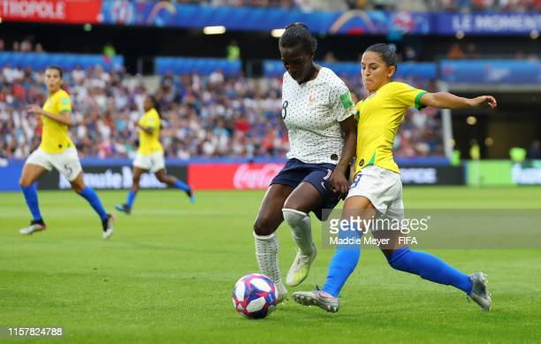 Viviane Asseyi of France is challenged by Debinha of Brazil during the 2019 FIFA Women's World Cup France Round Of 16 match between France and Brazil...